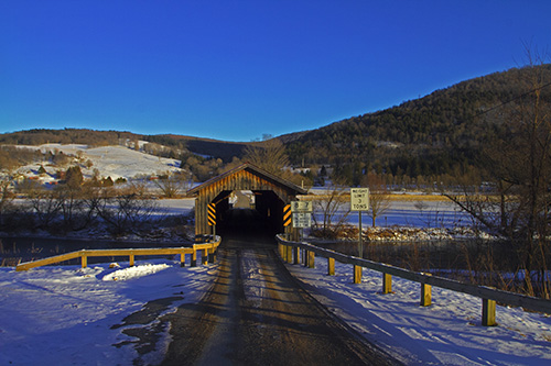 Snow and winter and covered bridges.